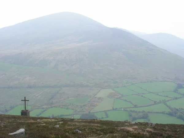 """15 foot high cross on Knockroe. Blackstairs Mtn beyond. "" from wicklore Contract pics"