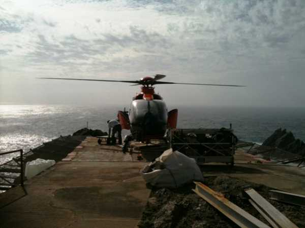 """Tiny helipad on An Tiaracht jutting out over the sea"" from wicklore Contract pics"
