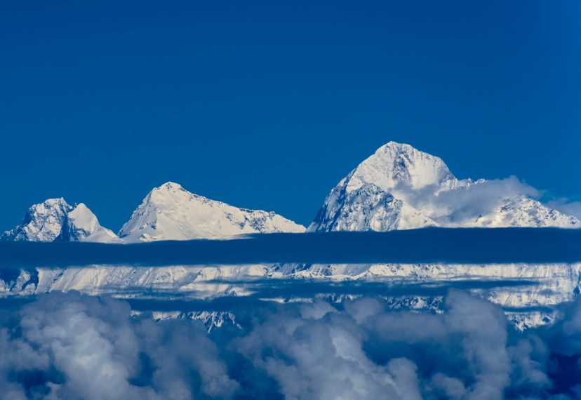 """Everest, THE mountain view, flanked by Lhotse on the left and Makalu on the right. Visible between Lhotse and Everest is the South Col and the slope to the south and main summits of Everest - the normal way of ascent from Nepal."" from mcrtchly Contract pics"